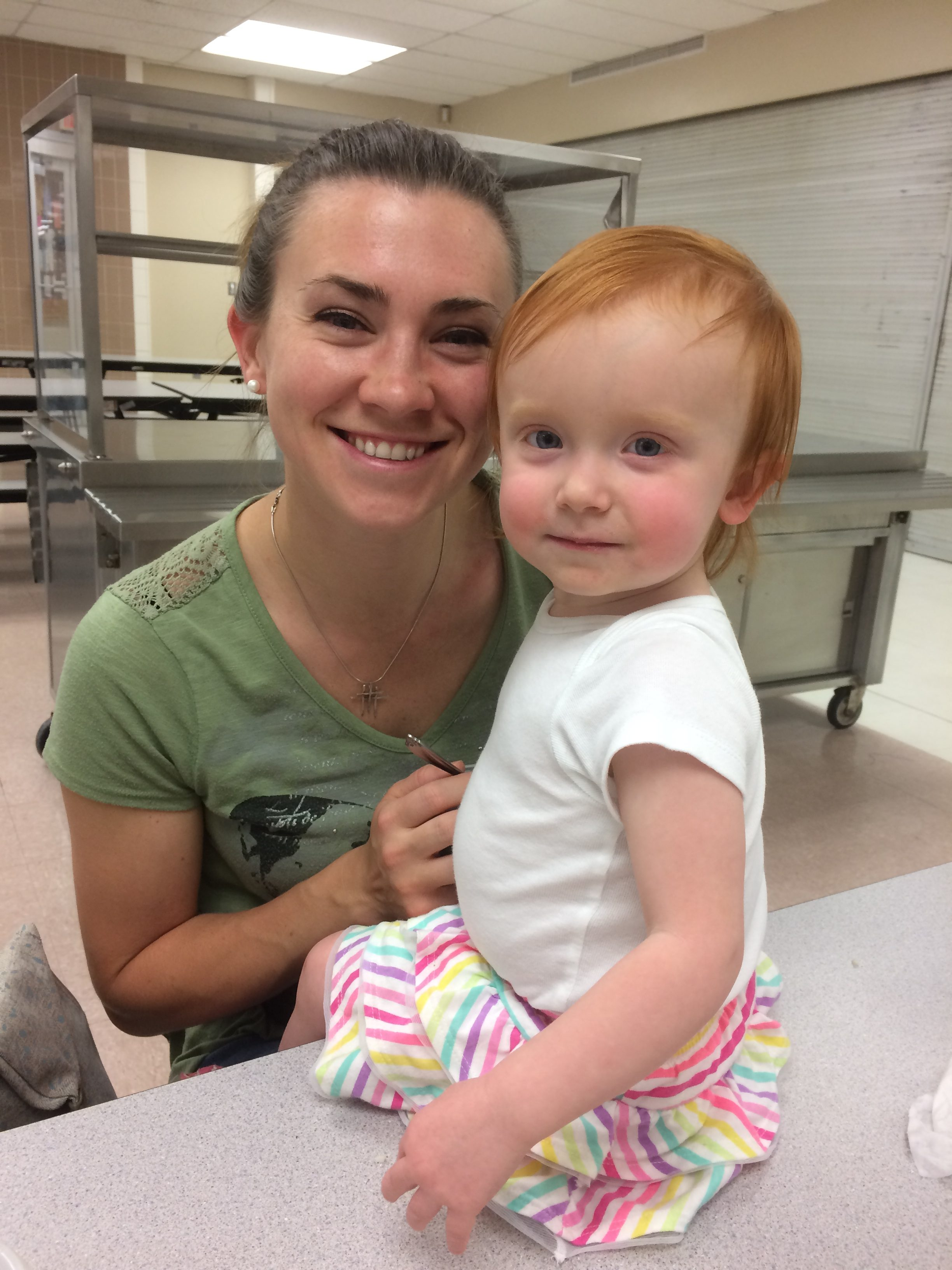 Photo of Presenter Blair Buselli's wife and child, Aurora and Ella, at the SEEDS DIY Solar Installation workshop.