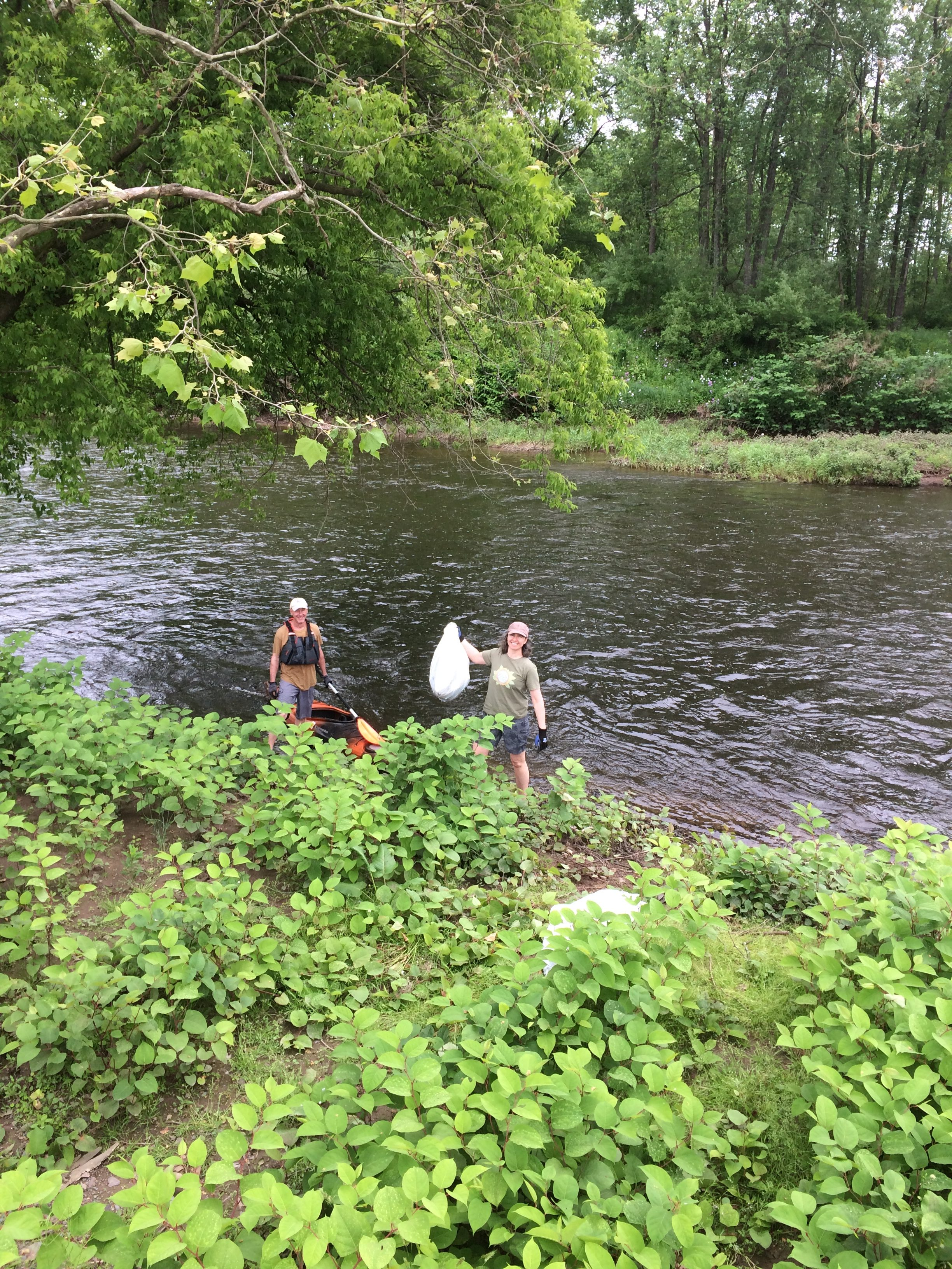 Photo of SEEDS board member David Ford and volunteer Krista Gromalski cleaning up a riparian zone on the Lackawaxen River.
