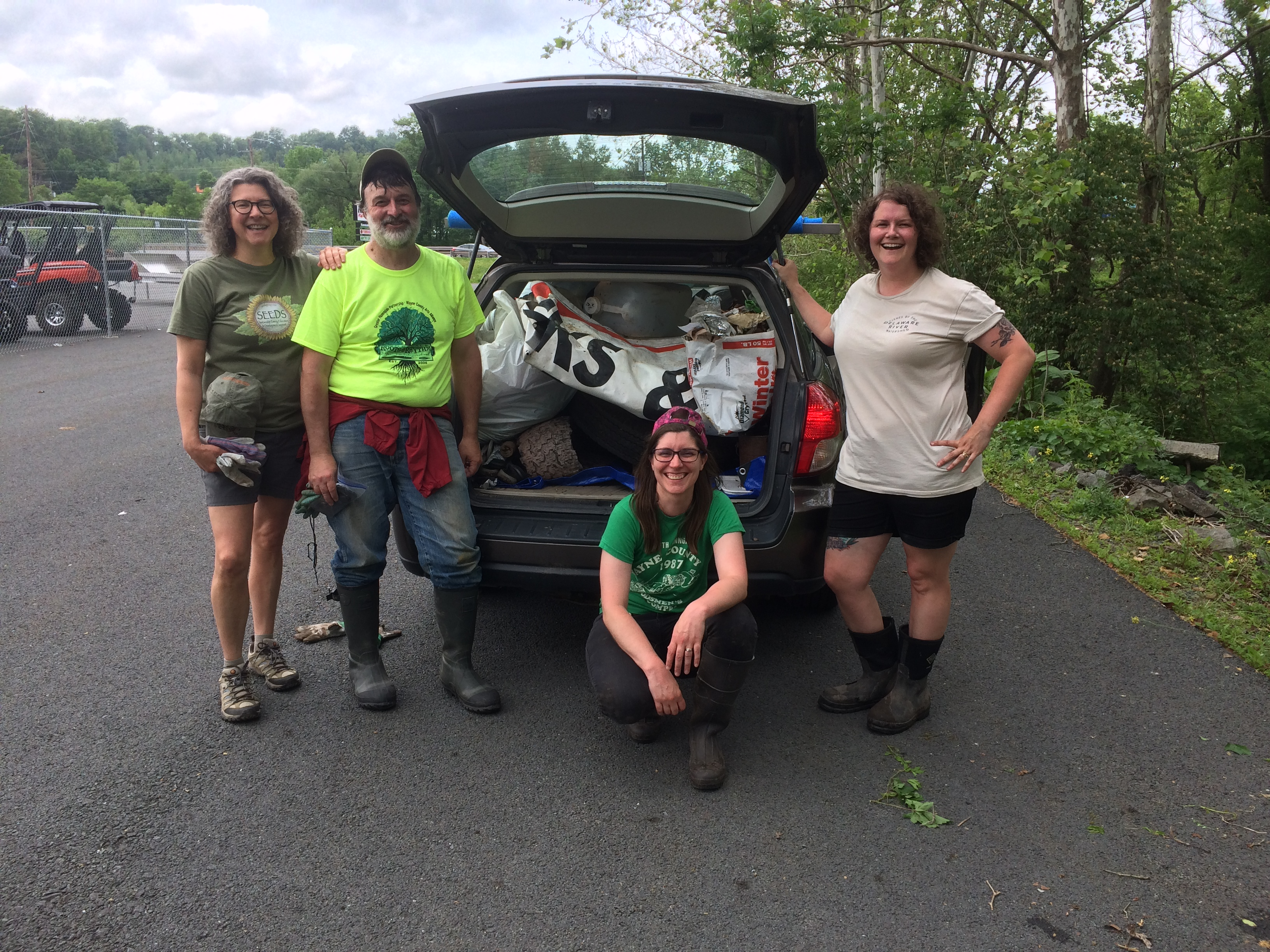 Photo of Seeds Executive Director Sandy Long, Board Member Jack Barnett, and Ashley and Sarah Hall-Bagdonas at the Lackawaxen River Clean Up.