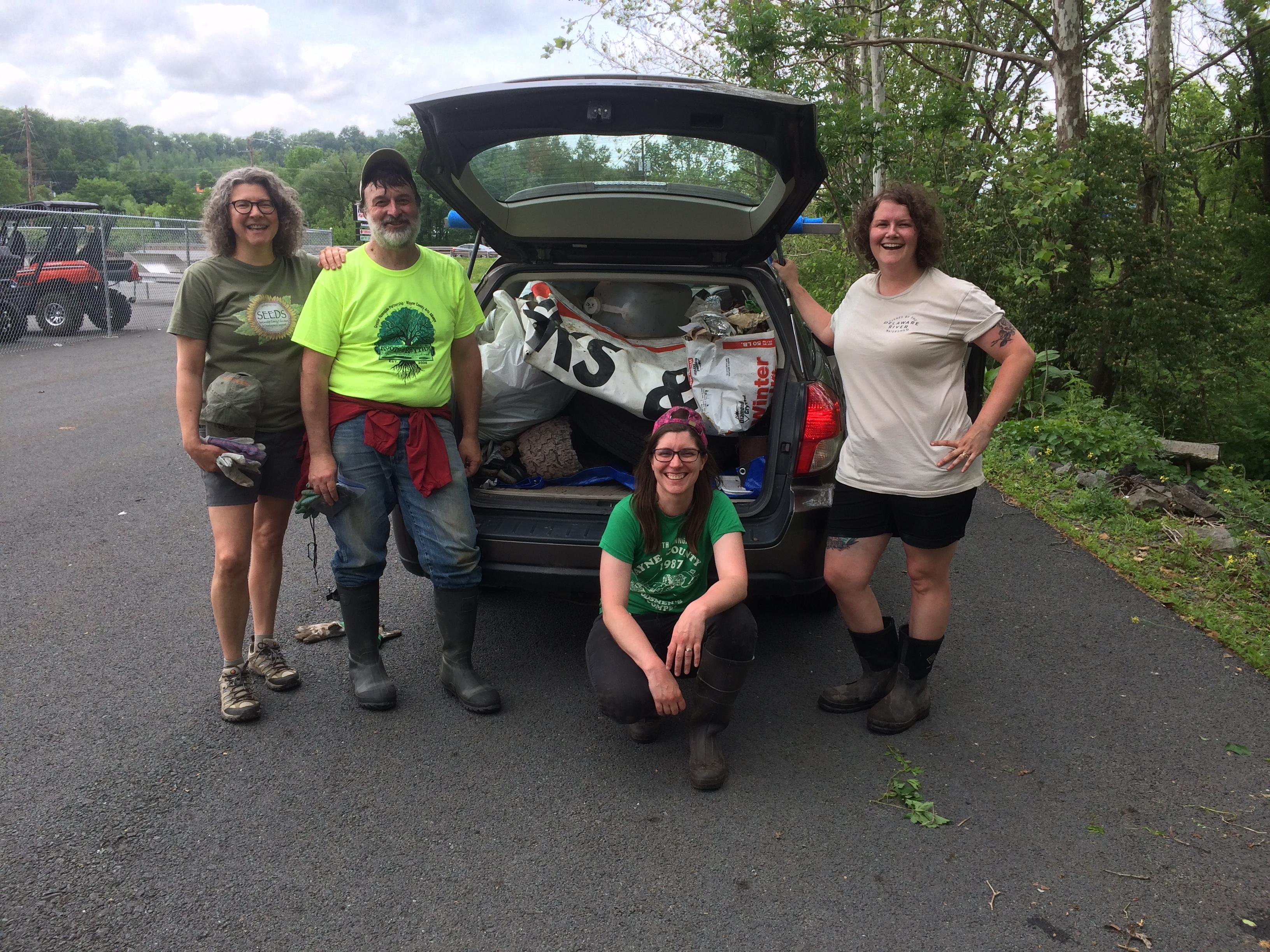 Photo of Seeds Executive Director Sandy Long, Board Member Jack Barnett, and Ashley and Sarah Hall-Bagdonas at the Lackawaxen River Clean Up.