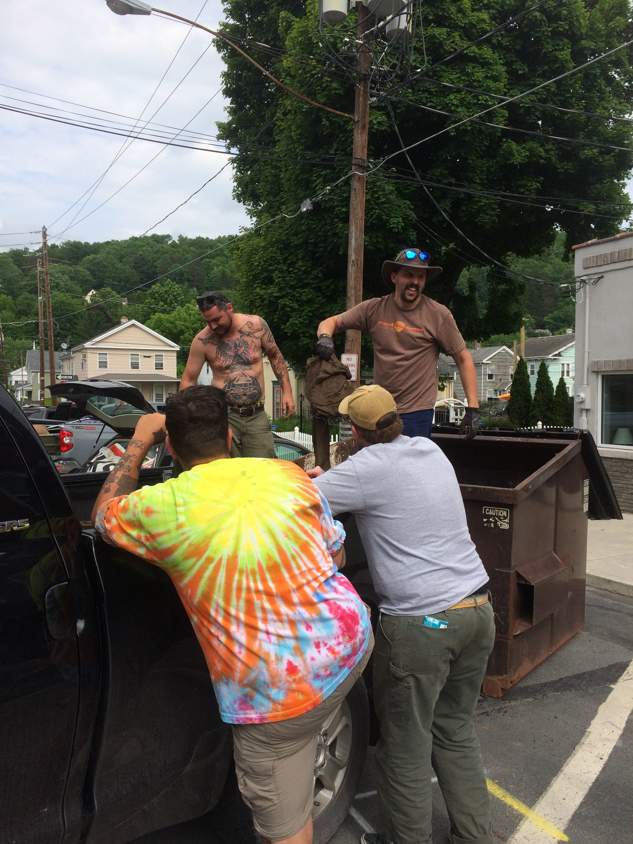 Photo of volunteers filling dumpsters at the Lackawaxen River Clean Up.
