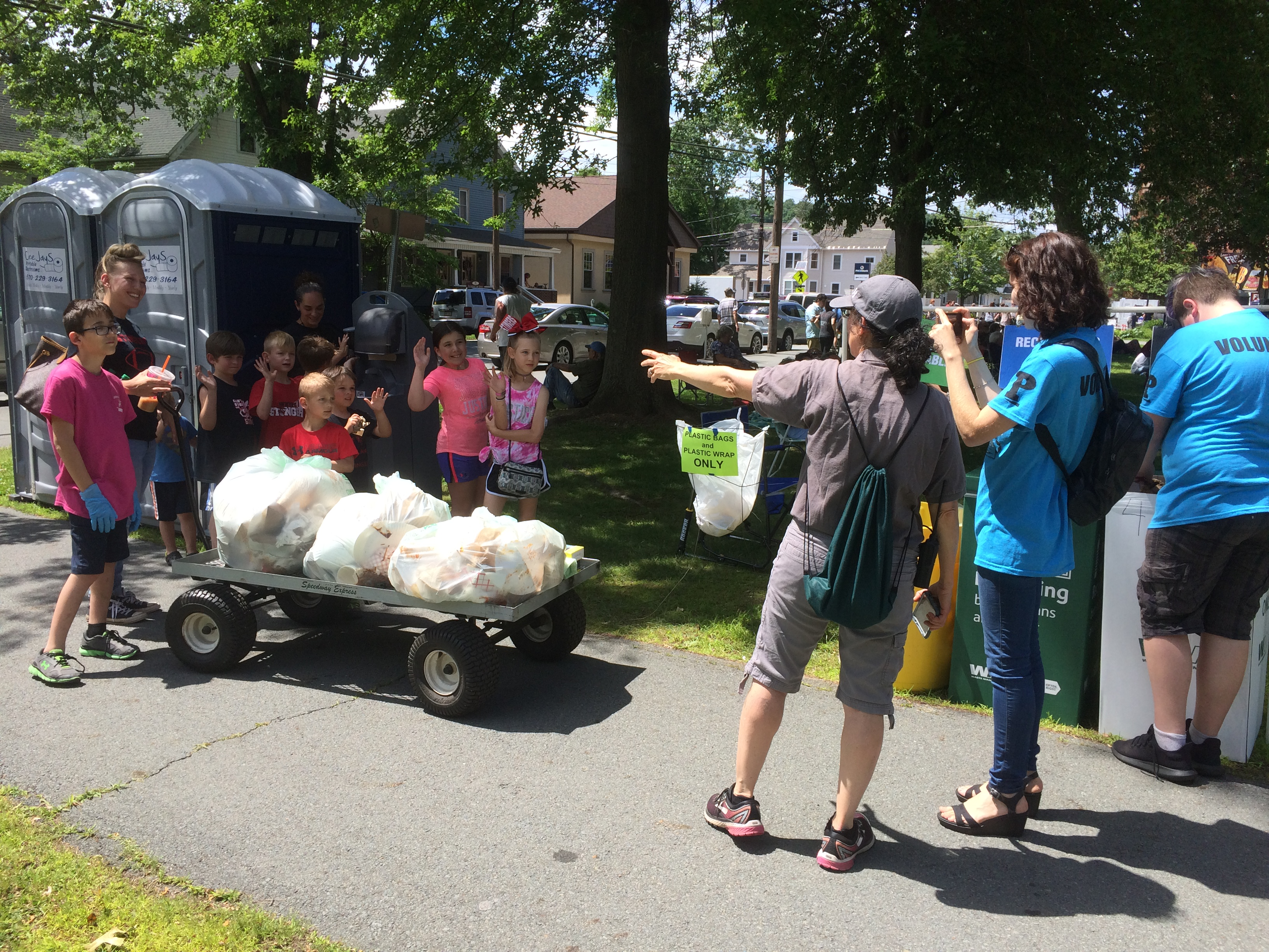 Photo of Cheryl Badner and young volunteers helping out with the recycling effort at the 2019 Honesdale Roots and Rhythm Festival.